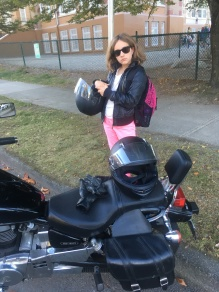 Pretty badass, riding to school with her mom.