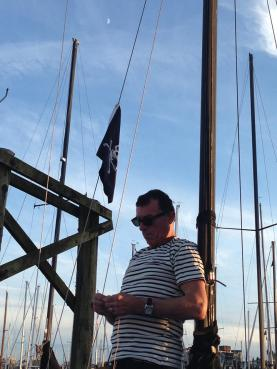 Paul onboard our sailboat with a Jolly Roger